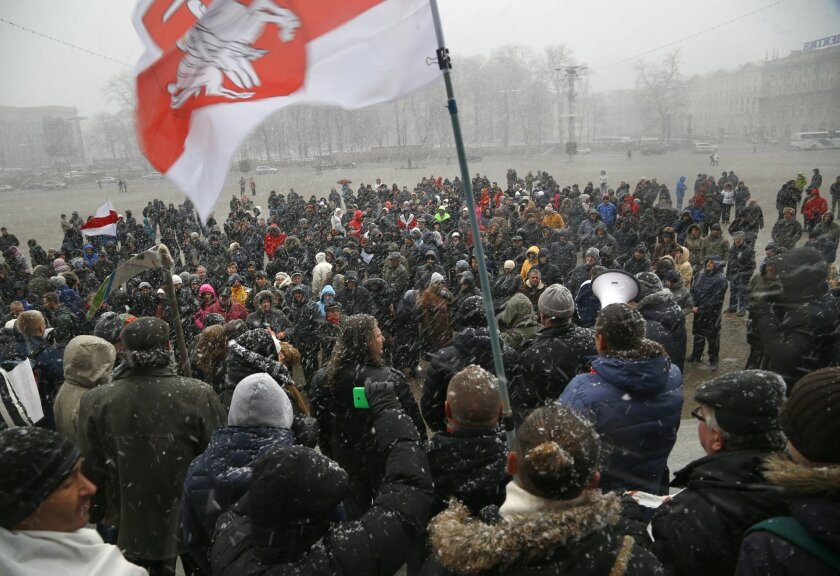 Belarusians attend a rally in support of sole traders in the city center in Minsk, Belarus, Sunday, Feb. 28, 2016. More than 500 people have marched through the capital of Belarus to demand that the government scrap new requirements for private businessmen that they say impose an unfair burden. (AP Photo/Sergei Grits)