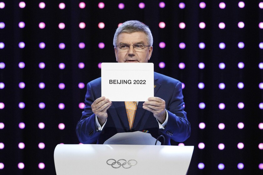 President of the International Olympic Committee Thomas Bach opens the envelope announcing that Beijing has won the bid to host the 2022 Winter Olympic Games at the 128th International Olympic Committee session in Kuala Lumpur, Malaysia, on July 31, 2015.