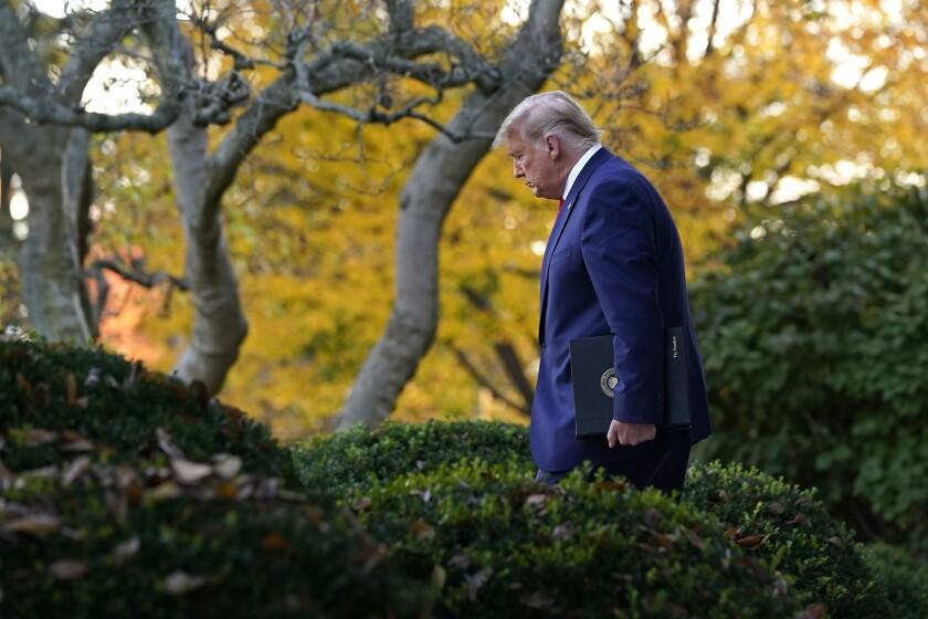 President Trump arrives to speak in the White House's Rose Garden on Nov. 13.