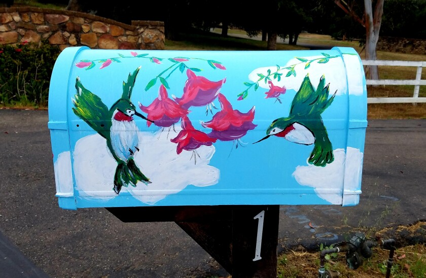 A mailbox Reich painted to brighten her friend's world during COVID.
