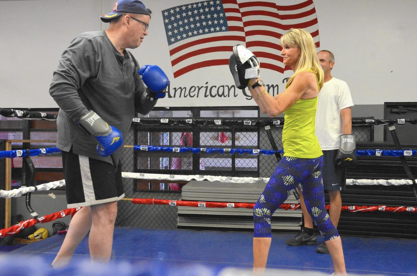 Parkinson's patient Gary Cragin takes a turn in the ring with certified personal trainer Anne Adams at American Gym in Costa Mesa, where Adams started California's first Rock Steady Boxing program four years ago.