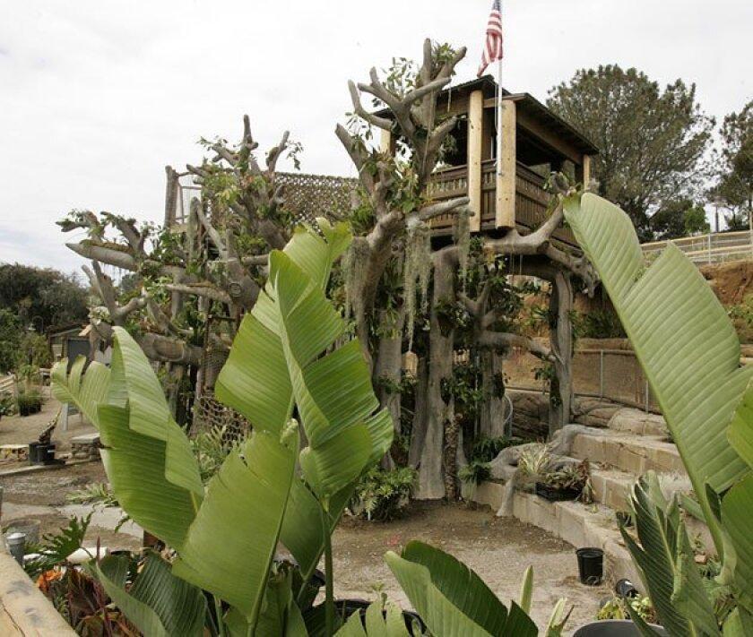 Toni's Treehouse, the centerpiece of the new Hamilton Children's Garden, has bridges, nets to climb, passageways and nooks for plants. (Laura Embry / Union-Tribune)