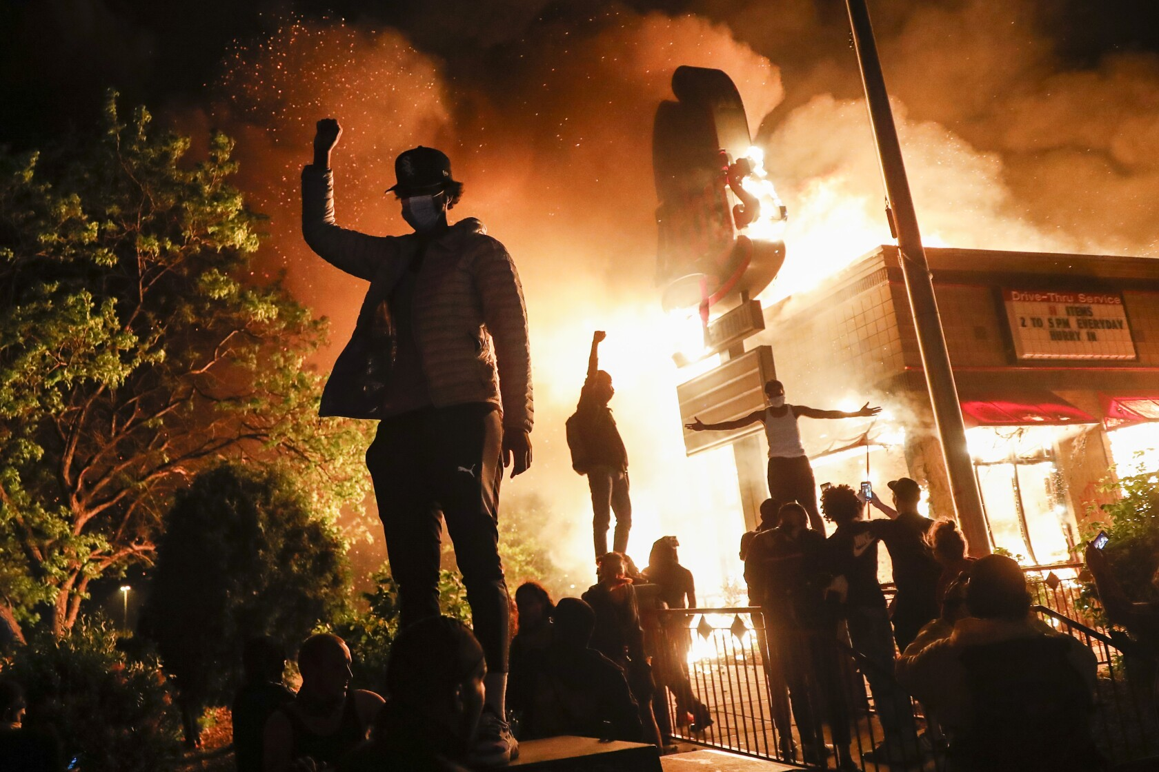 George Floyd protesters set Minneapolis police station afire - Los ...