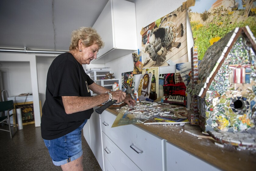 Robbie Britvich, 82, works on her mosaic art in the garage of her Newport Beach home on Monday.