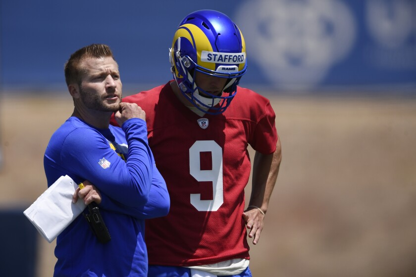 Rams head coach Sean McVay speaks with quarterback Matthew Stafford during a minicamp practice in Thousand Oaks.