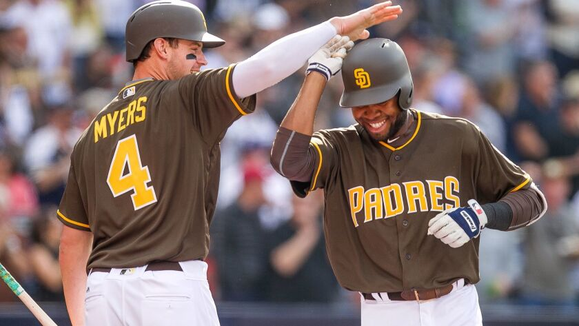 The Padres' Manuel Margot, right, is congratulated by Wil Myers after Margot hit his second home run in the third inning during the Padres home opener against the San Francisco Giants at Petco Park in San Diego on Friday, April 7, 2017.