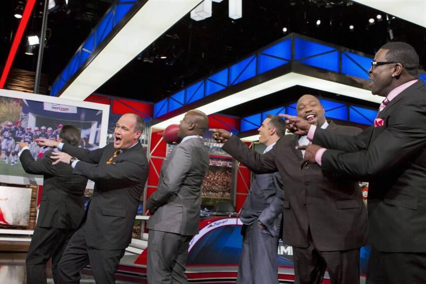"Rich Eisen, left, Steve Mariucci, Marshall Faulk, Kurt Warner, Warren Sapp and Michael Irvin on the set of the NFL Network's ""NFL Game Day Morning."""