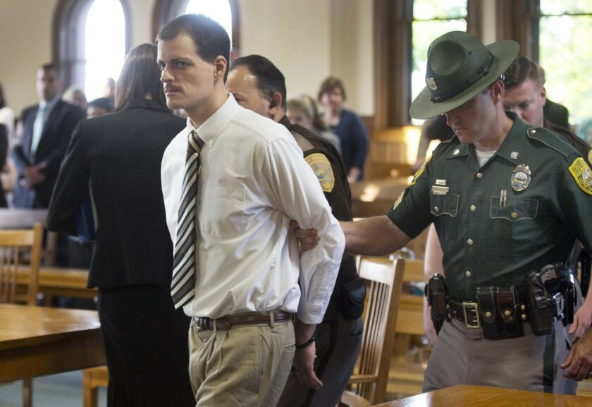Nathaniel Kibby is escorted out of the Belknap County Superior after pleading guilty and being sentenced 45-90 years in prison for kidnapping, rape, criminal threatening and witness tampering Thursday May 26, 2016 in Laconia, N.H. (AP Photo/Jim Cole)