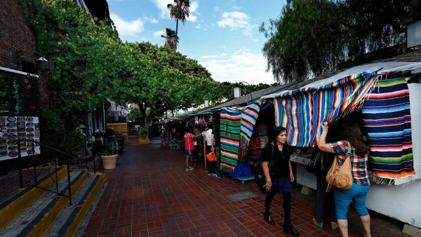 A commissioner at the city agency that oversees Olvera Street, above, has been hit with multiple harassment complaints.