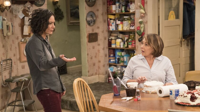 """This image released by ABC shows Sara Gilbert, left, and Roseanne Barr in a scene from """"Roseanne."""" T"""