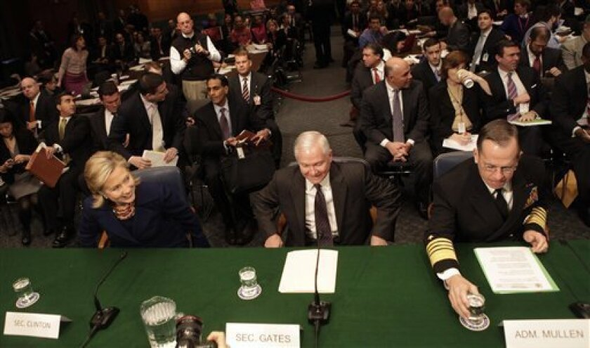 From left, Secretary of f State Hillary Rodham Clinton, Defense Secretary Robert Gates, and Joint Chiefs Chairman Adm. Mike Mullen, prepare to testify on Capitol Hill in Washington, Wednesday, Dec. 2, 2009, before the Senate Armed Services Committee hearing on the U.S. strategy in Afghanistan. (AP Photo/Pablo Martinez Monsivais)