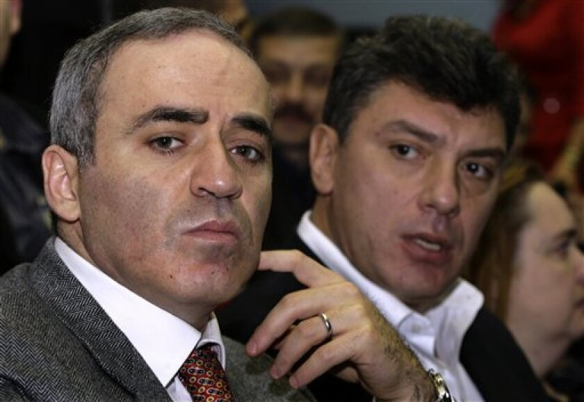 """Opposition leaders Garry Kasparov, the former chess champion, left, and Boris Nemtsov, right, attending the founding congress of a new opposition movement called """"Solidarity"""" in Khimki, outside Moscow, Saturday, Dec. 13, 2008. (AP Photo/Mikhail Metzel)"""