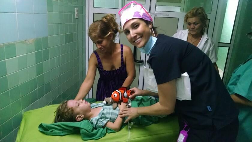 Plasticos volunteer nurse Danielle McConnell tends to a patient in Cuba.