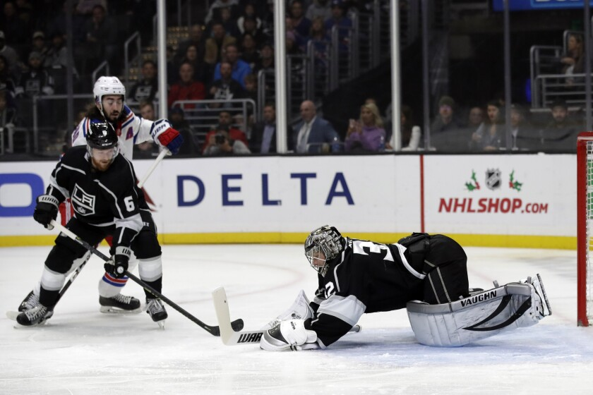 Kings goaltender Jonathan Quick stops a Rangers shot during the first period of a game Dec. 10 at Staples Center.