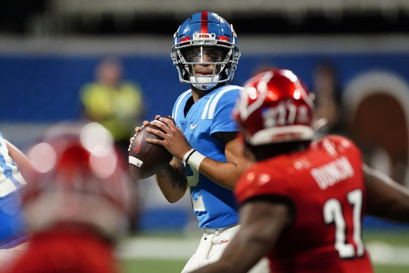 Mississippi quarterback Matt Corral looks for an open receiver during the first half against Louisville.