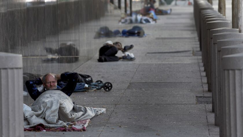 LOS ANGELES, CA JULY 4, 2018: Lewis Payne, 55, laying on the sidewalk for the night on Aliso Stre