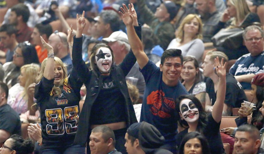 L.A. KISS fans got into the spirit of the night on Saturday for the new Arena Football League team's home opener at the Honda Center.