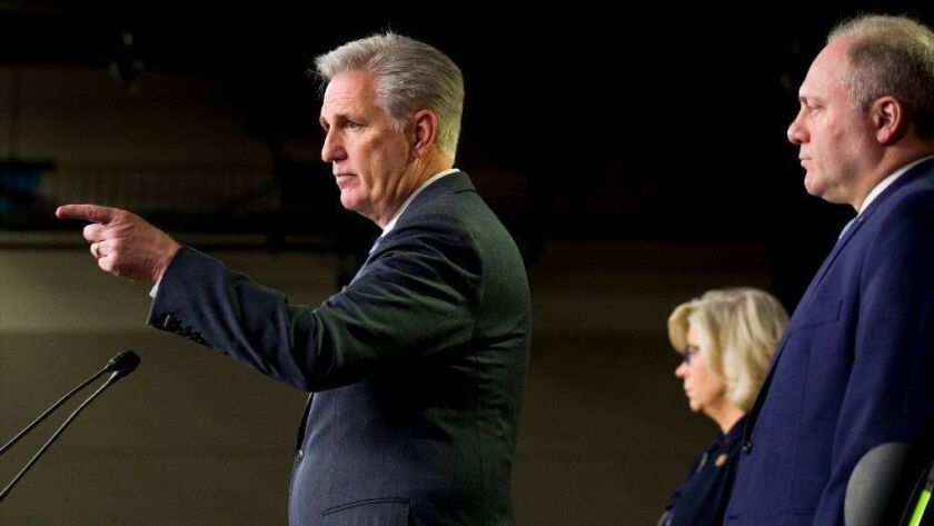 House Minority Leader Kevin McCarthy points to a questioner at a news conference, joined by Republican leadership lieutenants Reps. Liz Cheney and Steve Scalise.