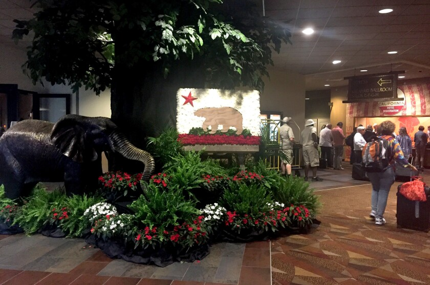 California delegates check in to their hotel, an African-themed resort in Sandusky, Ohio, about 60 miles away from the site of the GOP convention. They have the longest commute of any of the states' delegates.
