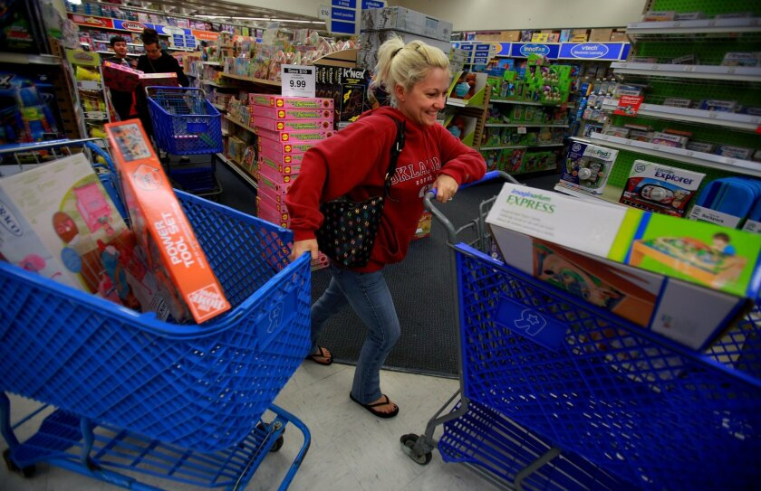 U-T File: Jeni Baldus of San Diego was one of the first shoppers in line at Toys 'R' Us on Morena Blvd. when the doors opened at 8 p.m. Thanksgiving Day last year. This year, Black Friday will still be the busiest shopping day of the year, but ShopperTrak predicts the last four days before Christma