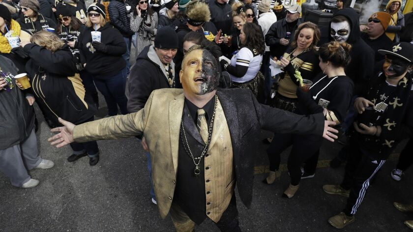 Saints fans gather outside Mercedes-Benz Superdome before the NFC championship game.