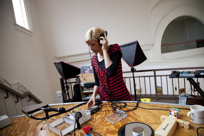 "Artist Margaret Noble records a variety of sounds from music boxes to child toys in her downtown loft to produce sounds for use in her multimedia installation named ""44th and Landis"" to be held at th Museum of Contemporary Art."