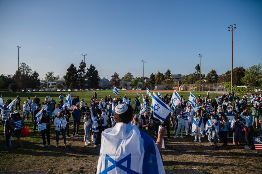 Micah Danzig of StandWithUs speaks at a pro-Israel rally at the Lawrence Family Jewish Community Center in La Jolla.