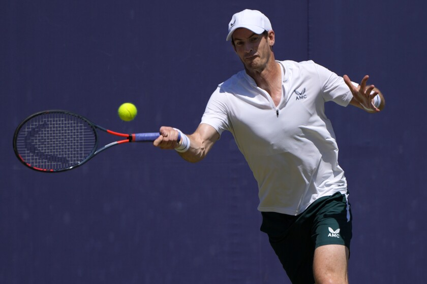 Andy Murray of Britain plays a shot during a practice session at the Queens Club tennis tournament in London, Monday, June 14, 2021. (AP Photo/Kirsty Wigglesworth)