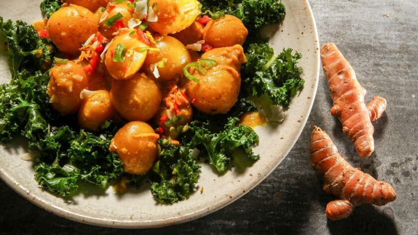 Turmeric-braised baby potatoes with coconut kale.