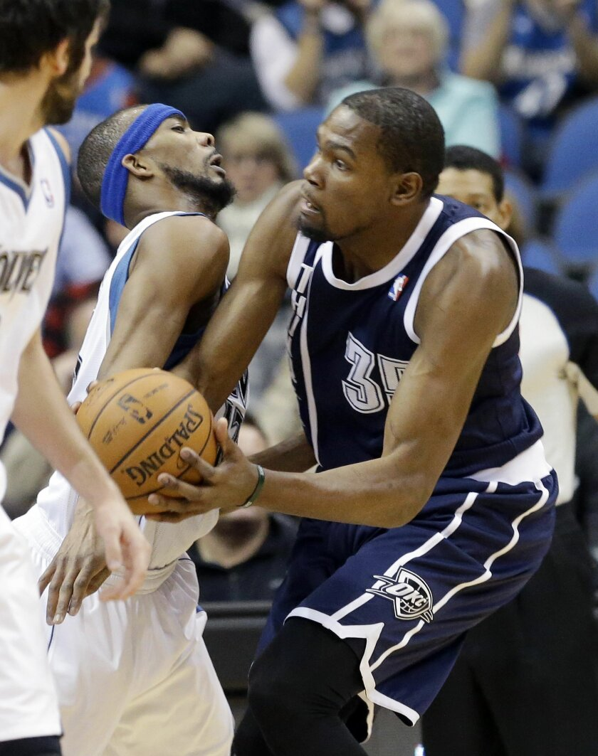 Oklahoma City Thunder's Kevin Durant, right, bumps into Minnesota Timberwolves' Corey Brewer during the first quarter of an NBA basketball game Saturday, Jan. 4, 2014, in Minneapolis. (AP Photo/Jim Mone)