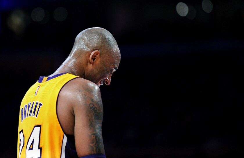 Kobe Bryant takes a moment to catch his breath during his final game against the Utah Jazz.