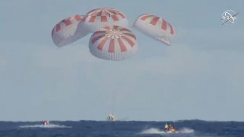 SpaceX's Crew Dragon capsule splashes down
