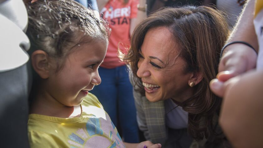HOMESTEAD, FLORIDA - JUNE 28: Democratic presidential candidate, Sen. Kamala Harris (D-CA) speaks with Roxanna Gozzer, whose mother is originally from El Salvador and is in the U.S. under Temporary Protected Status, as she visits the outside of a detention center for migrant children on June 28, 2019 in Homestead, Florida. Democratic presidential candidates visited the detention center, which is the nation's largest center for detaining immigrant children, as the candidates spend time in the Miami area after participating in a nationally televised debate. (Photo by Joe Raedle/Getty Images) ** OUTS - ELSENT, FPG, CM - OUTS * NM, PH, VA if sourced by CT, LA or MoD **