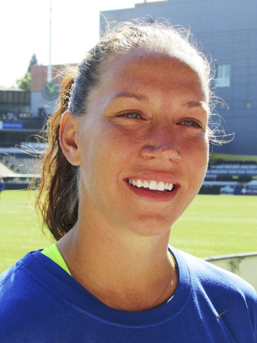 FC Kansas City midfielder Lauren Holiday speaks to reporters before a soccer practice Wednesday, Sept. 30, 2015, in Portland, Ore. Holiday, who also plays for the World Cup-winning U.S. women's national team, will retire from soccer following Thursday night's NWSL championship game between Kansas City and the Seattle Reign at Providence Park. (AP Photo/Anne M. Peterson)
