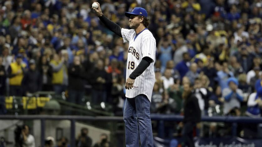 Robin Yount throws the ceremonial first pitch before Game 7 of the National League Championship Series between the Milwaukee Brewers and Dodgers.