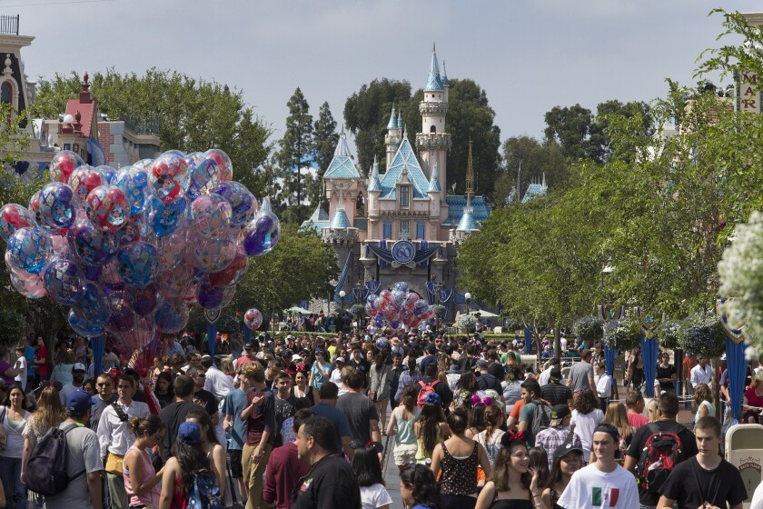 Disneyland crowds swell during the park's 60th anniversary celebration.