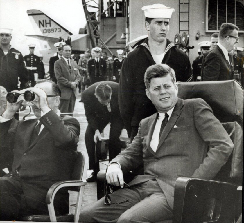 06/06/1963: Aboard the carrier Kitty Hawk. President Kennedy and Gov. Edmund G. Brown (with binoculars) on the deck of the carrier Kitty Hawk off the southern California coast. Kennedy watched the Navy put on a two hour show of its might. AP wirephoto (T 6/7/63)