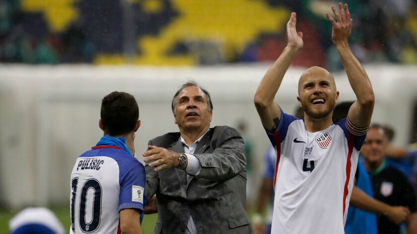 U.S. Coach Bruce Arena, center, celebrates with Christian Pulisic as Michael Bradley salutes supporters following a 1-1 tie with Mexico on June 11.