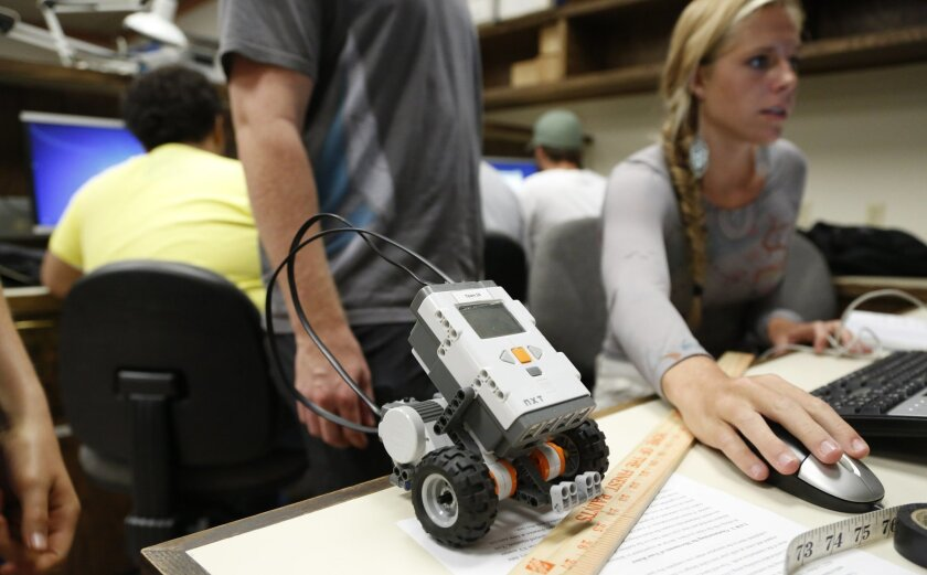 Lauren Hoffman, 19, makes adjustments to programming for a robot in Professor Michael Morse's introduction to engineering course. Darlene Shiley is donating $20 million to the University of San Diego to turn its department of engineering into a School of Engineering.