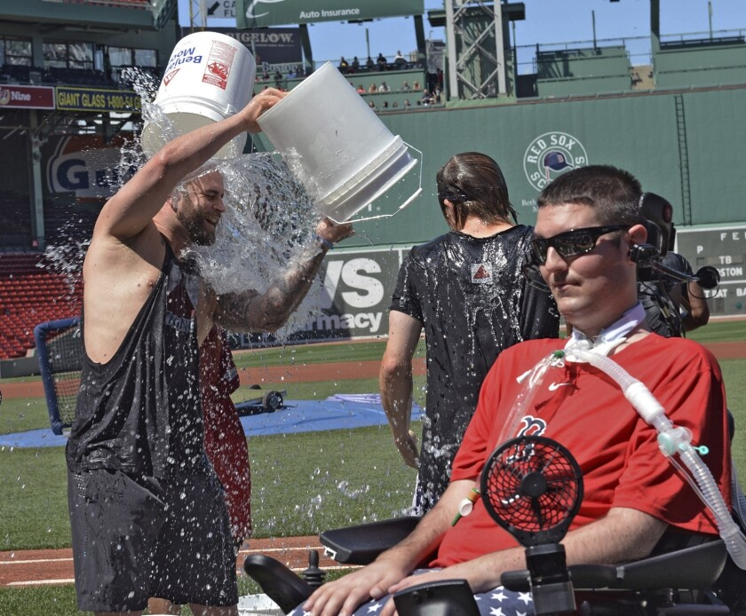 Boston Red Sox player Mike Napoli takes part in the relaunch of the Ice Bucket Challenge as former Boston College baseball player Pete Frates, right, looks on at Fenway Park in Boston on July 31, 2015.