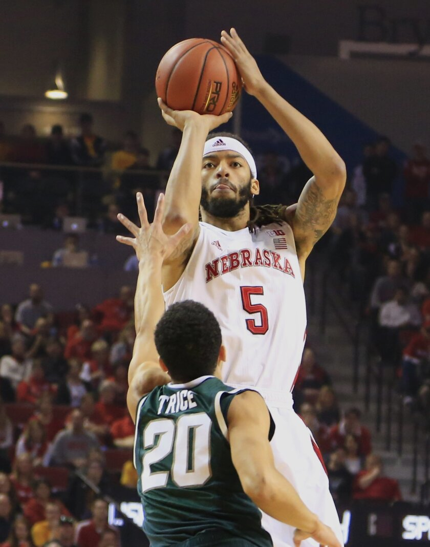 Nebraska's Terran Petteway (5) shoots over Michigan State's Travis Trice (20) during the first half of an NCAA college basketball game in Lincoln, Neb., Saturday, Jan. 24, 2015. (AP Photo/Nati Harnik)