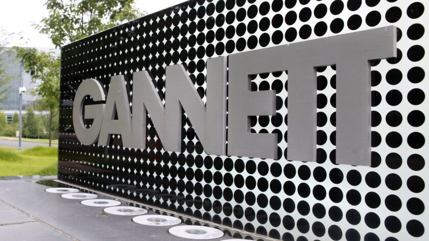 FILE - In this July 14, 2010, file photo, the Gannett Co.headquarters sign stands in McLean, Va. The