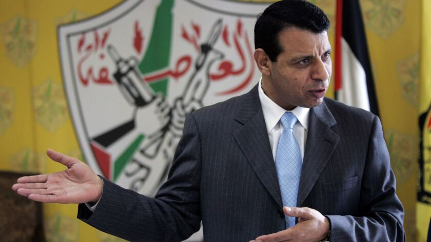 Palestinian Fatah leader Mohammed Dahlan gestures as he speaks during an interview on Jan. 3, 2011, in the West Bank city of Ramallah.