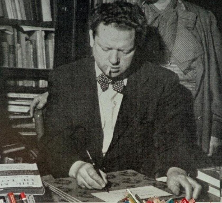 A poster of Dylan Thomas, with his ever-present dangling cigarette, at the Dylan Thomas Centre bookshop-cafe in Swansea.