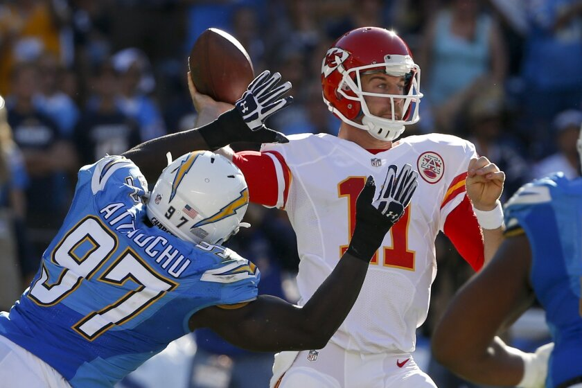 Kansas City Chiefs quarterback Alex Smith (11) throws a pass as San Diego Chargers linebacker Jeremiah Attaochu (97) defends during the first half of an NFL football game Sunday, Nov. 22, 2015, in San Diego. (AP Photo/Lenny Ignelzi)