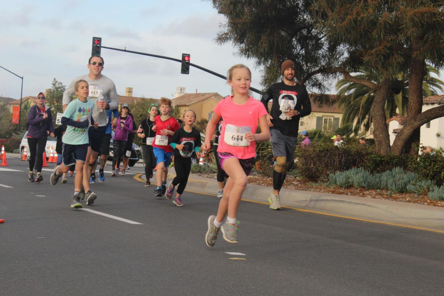 A young runner on Carmel Valley Road.