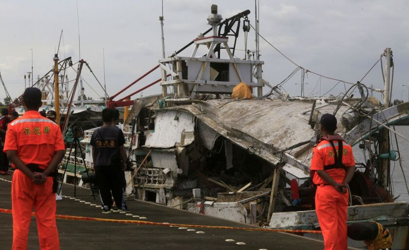 One person was killed when a Taiwanese missile went off course and struck a fishing boat Friday. A photograph released by Taiwan's Central News Agency shows the damaged boat at a southern Taiwan port.