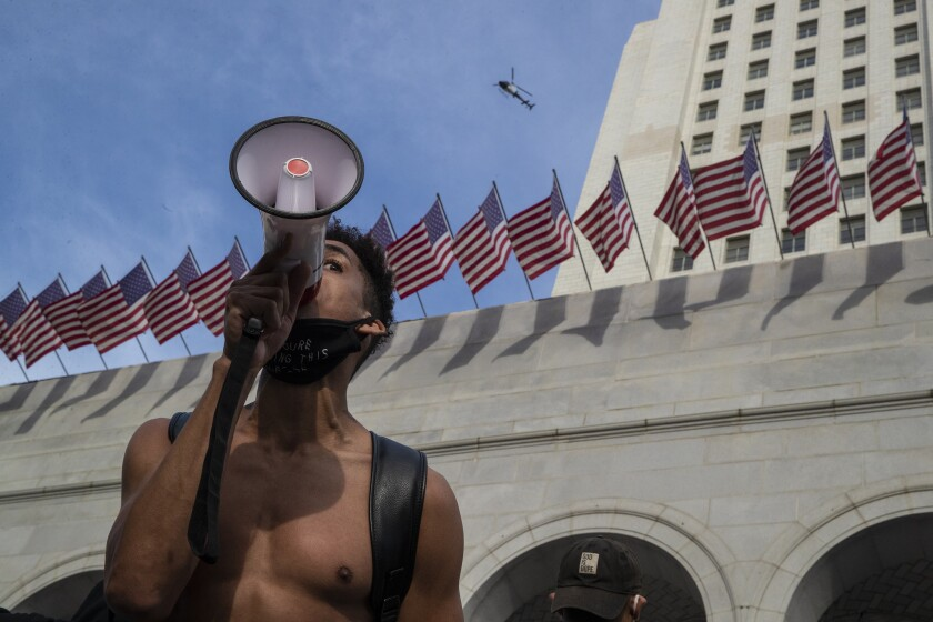 Marcus Owen, with bullhorn, outside Los Angeles City Hall