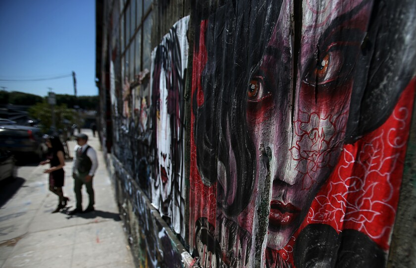 The Los Angeles City Council voted 13-2 on Wednesday to lift a decade-old ban on murals. Above, a mural in downtown L.A.