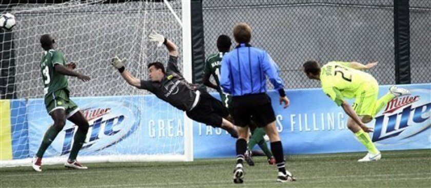 Seattle Sounders forward Nate Jaqua, right, heads the ball into the net past Portland Timbers goalkeeper Steve Cronin during the first half of third round play in the Lamar Hunt U.S. Open Cup soccer tournament in Portland, Ore., Wednesday, June 30, 2010.(AP Photo/Don Ryan)